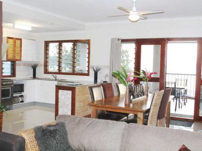 Vanuste Beachfront Apartments Kitchen and Lounge